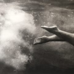Figurative artist Patsy McArthur. Monochrome charcoal drawn feet swimming and kicking in water